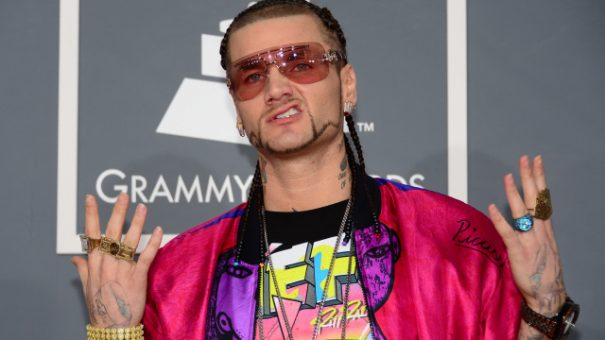 Rapper Riff Raff arrives on the red carpet at the Staples Center for the 55th Grammy Awards in Los Angeles, California, February 10, 2013. AFP PHOTO Frederic J. BROWN        (Photo credit should read FREDERIC J. BROWN/AFP/Getty Images)